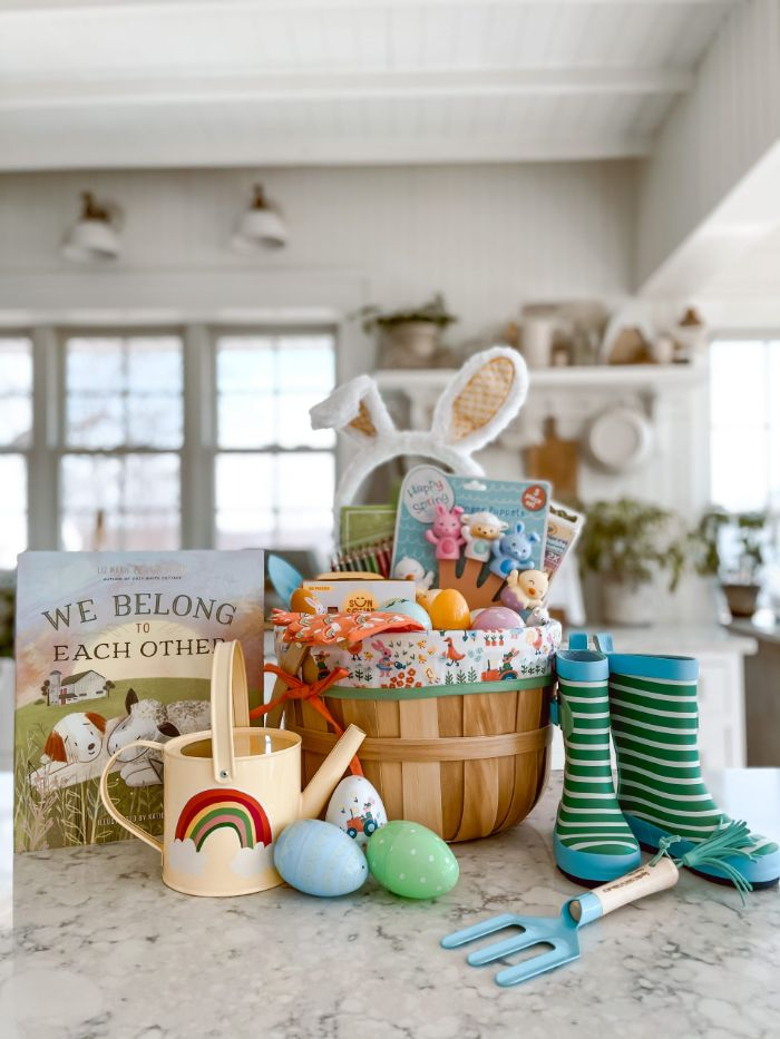 easter baskets for kids filled with plastic eggs toys childrens book candy placed on marble surface