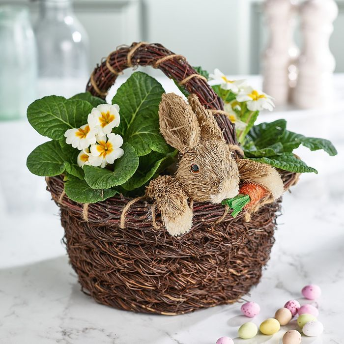 easter crafts easter basket with flowers inside mini bunny toy coming out of the basket