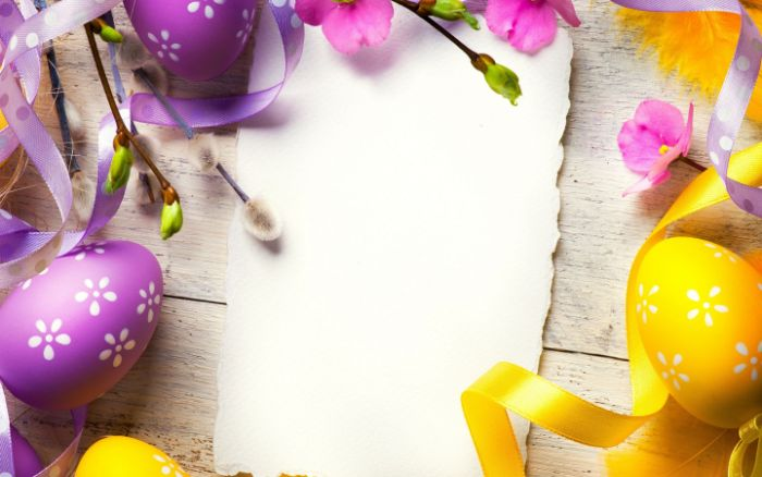 easter wallpaper purple and yellow eggs with white flowers drawn on them next to white piece of paper