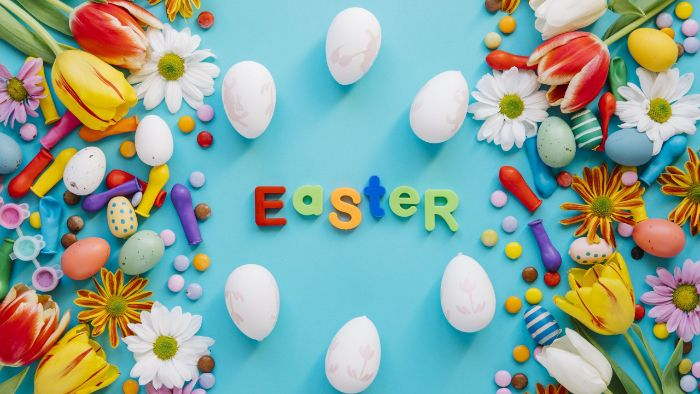 easter written on blue background easter wallpaper surrounded by easter eggs colorful flowers and balloons