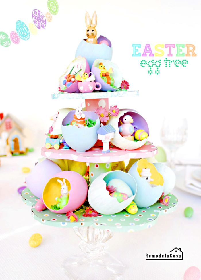 easy easter crafts tree centerpiece made from carton with egg shells and easter themed figurines