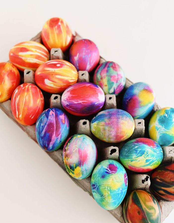 egg carton easter egg designs lots of tie dye eggs arranged on it on white background