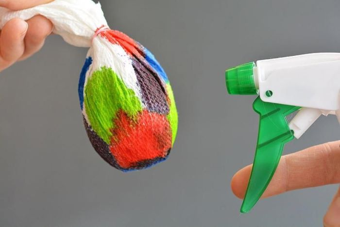 egg wrapped in paper towel soaked in different colors how to color easter eggs sprayed with water