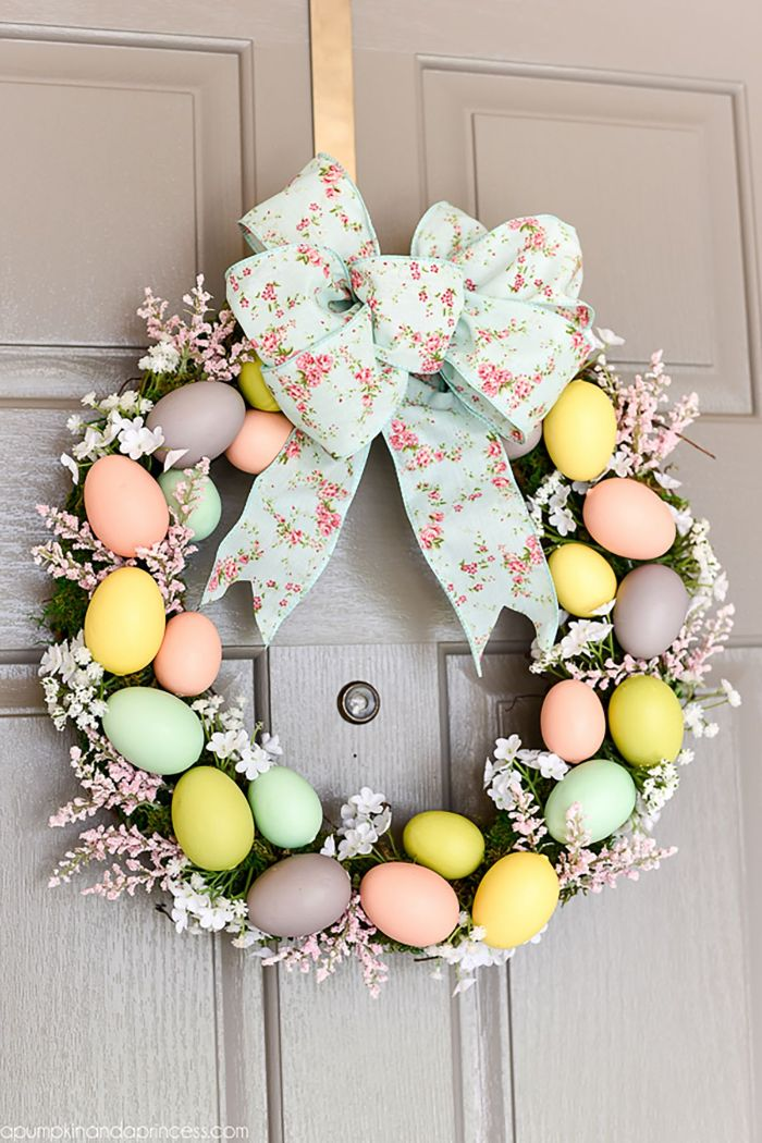 egg wreath made with faux pink and blue flowers easter crafts eggs blue floral ribbon in the middle
