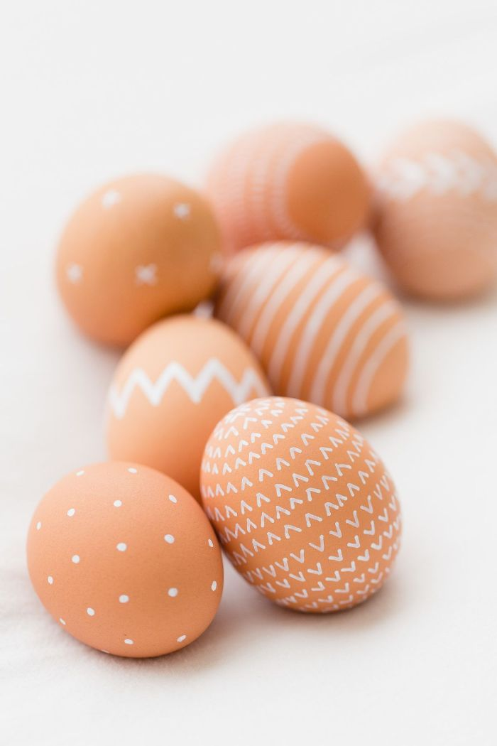 eggs decorated with different white patterns free easter wallpaper placed on white surface