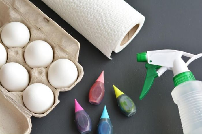 eggs dyed in different colors paper towels spray bottle with water how to color easter eggs step by step diy tutorial