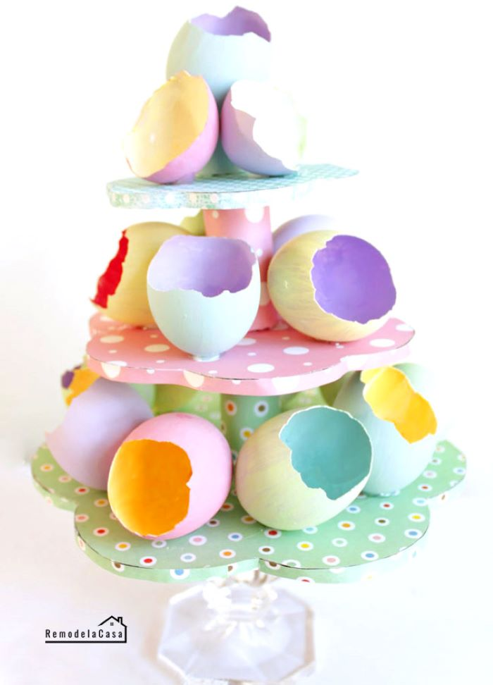 empty egg shells painted in different colors placed on carton stand easy easter crafts