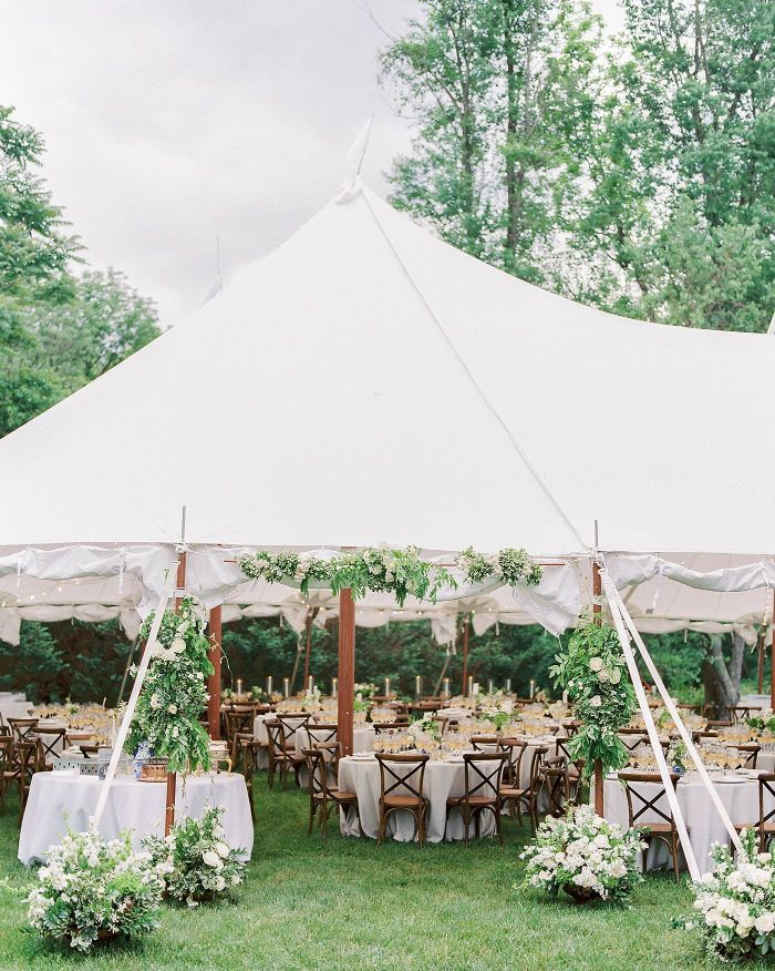flower arrangements all over entrance to tent diy wedding ideas lots of round tables under the tent