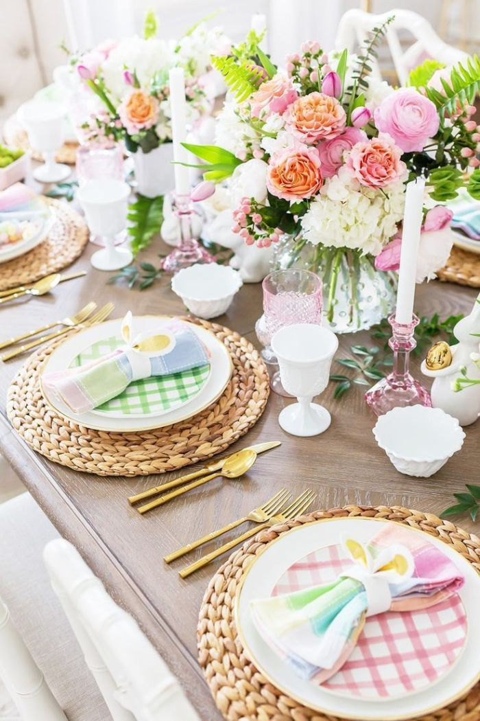 flowers in white ceramic vases in the middle of the table easter decoration ideas plate settings with colorful plates and napkins