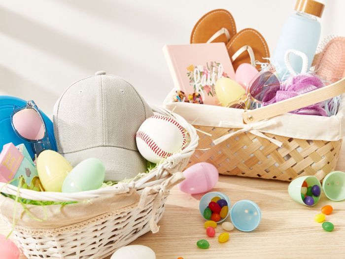girl and boy easter baskets for kids one with sports items other with beauty items plastic eggs