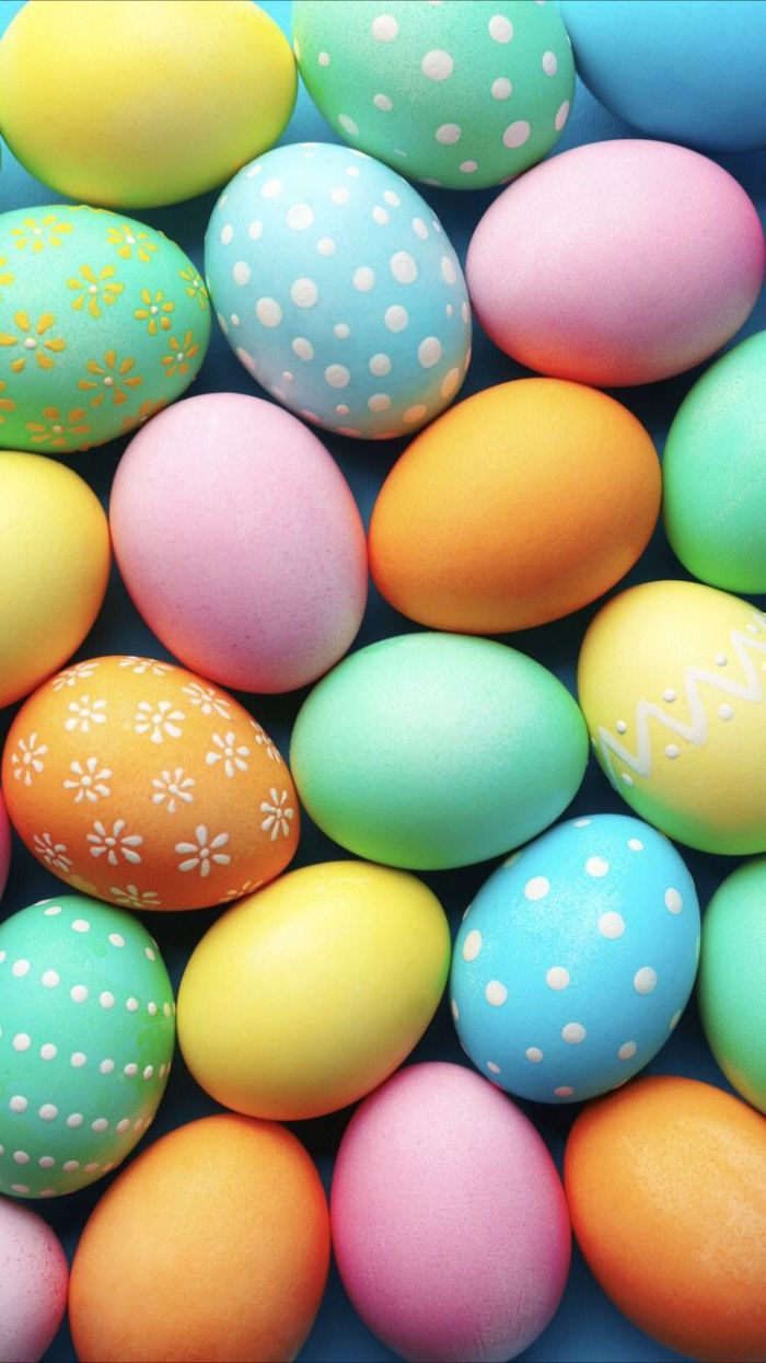 green blue orange pink easter eggs with different patterns free easter wallpaper placed on blue surface