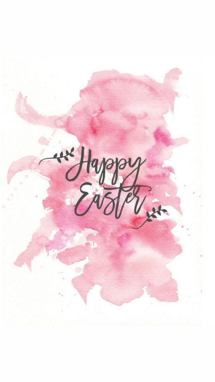 happy easter written in cursive on pink watercolor background easter background free