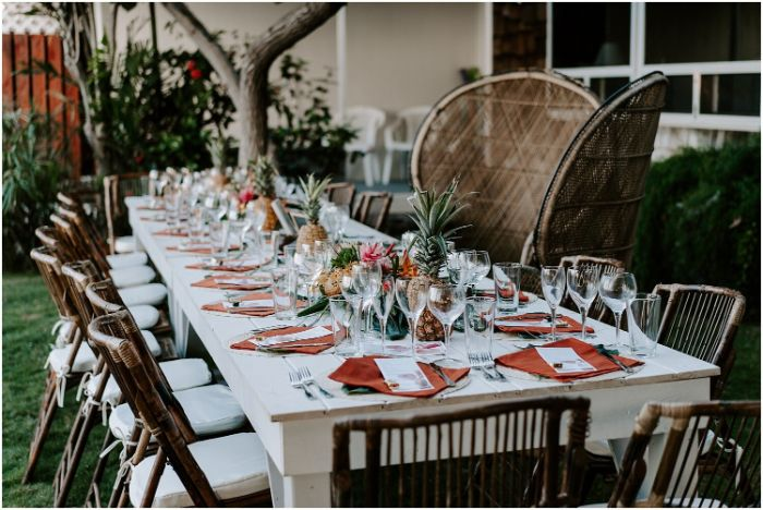 hawaiian style wedding outside wedding ideas pineapples used as centerpieces with rattan furniture