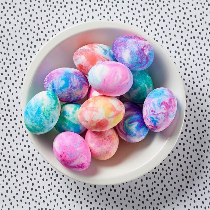 homemade egg dye white bowl filled with eggs in different colors dyed with shaving cream