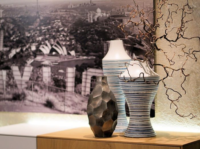 ideas to use in your interior three vases placed on wooden cabinet framed photo of los angeles skyline