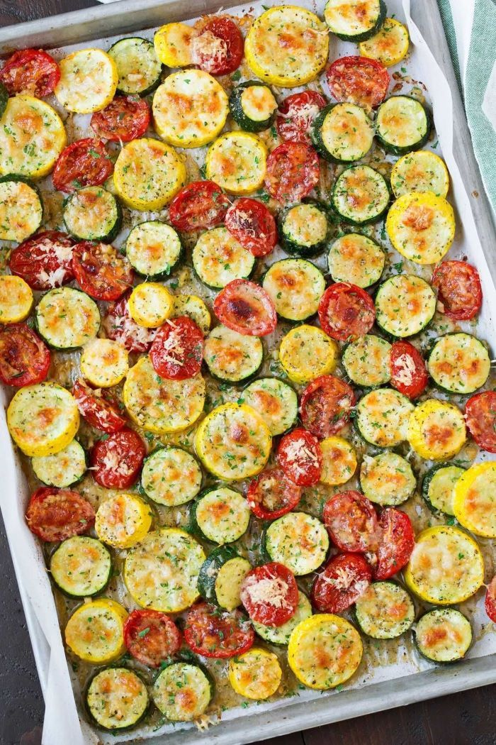 large sheet pan how to cook yellow squash zucchini and tomato slices arranged on it with cheese