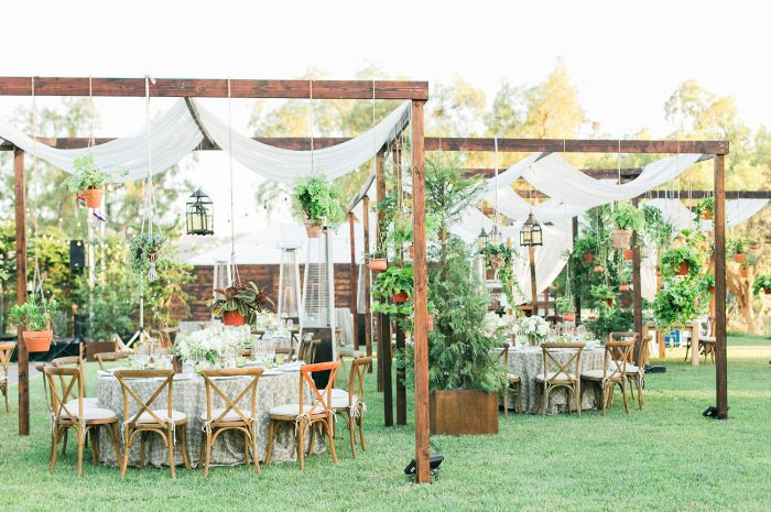 macramé planters white curtains hanging from wood poles diy wedding ideas boho style garden wedding