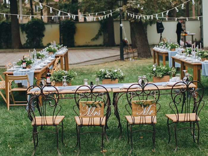 mrs and mr personalized chair signs outside wedding ideas tables arranged under strings of lights