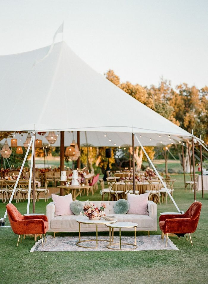 simple wedding decorations lounge area with large white sofa two brown velvet armchairs