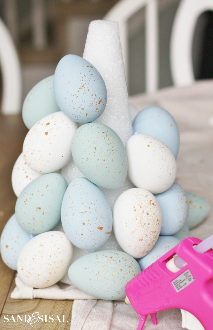 step by step diy tutorial easter decorations 2021 attaching eggs to topiary centerpiece