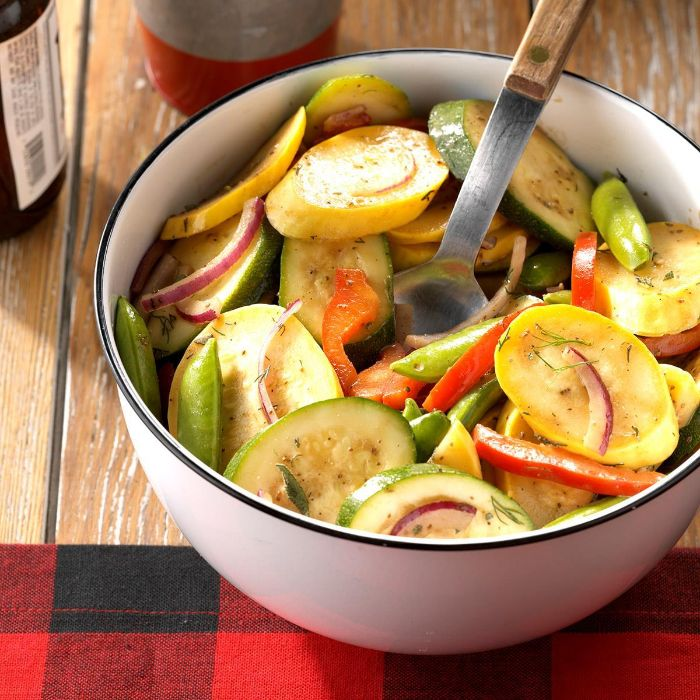 summer salad with squash zucchini onion peppers in white bowl how to cook squash