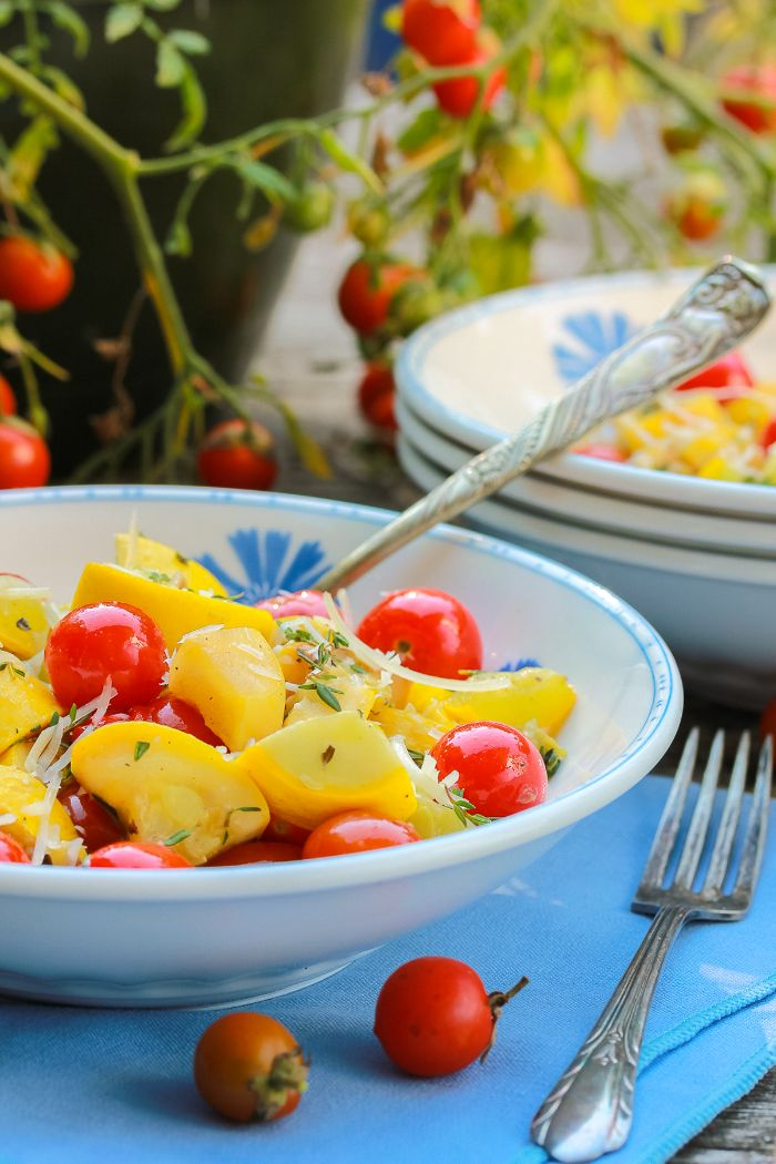 summer salad with yellow squash and cherry tomatoes how to cook squash garnished with cheese and thyme