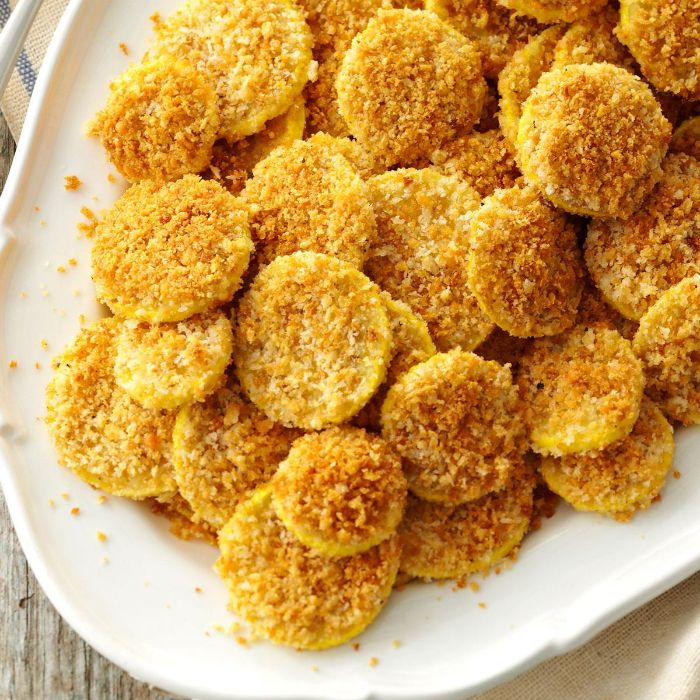 summer squash recipes small bites baked covered with breadcrumbs and parmesan cheese on white plate