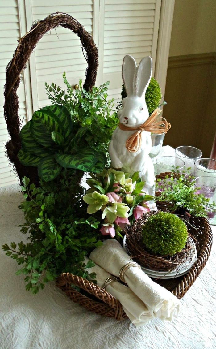 table centerpiece with green potted plants easter crafts white ceramic bunny in a basket