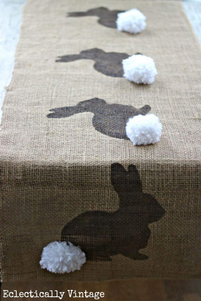 table runner made from burlap easter table décor bunny pattern with white pom poms