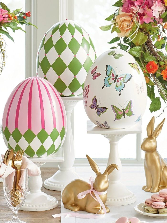 three large ceramic eggs decorated in pink green with butterflies easter decorations gold bunny figurines