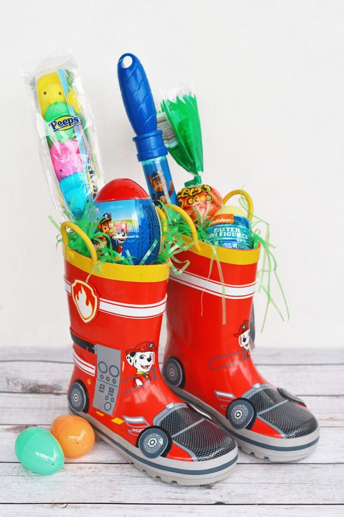 two kids boots filled with different candy easter basket ideas easter toys inside