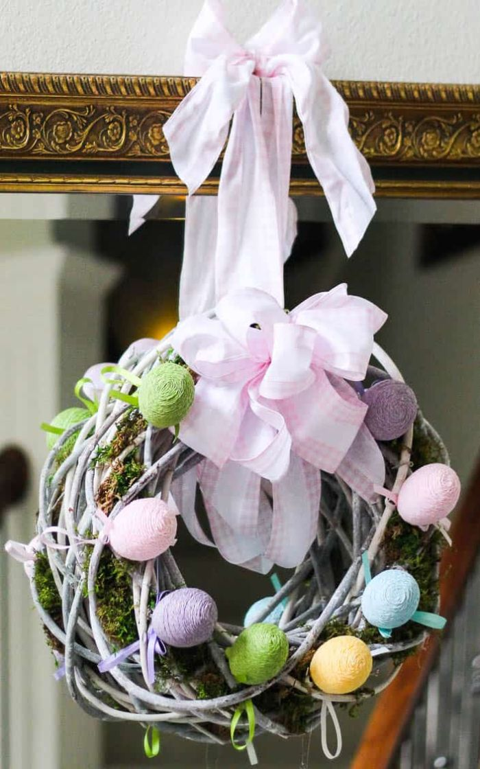 wreath made with white branches faux moss and eggs diy easter decorations large pink and white ribbon