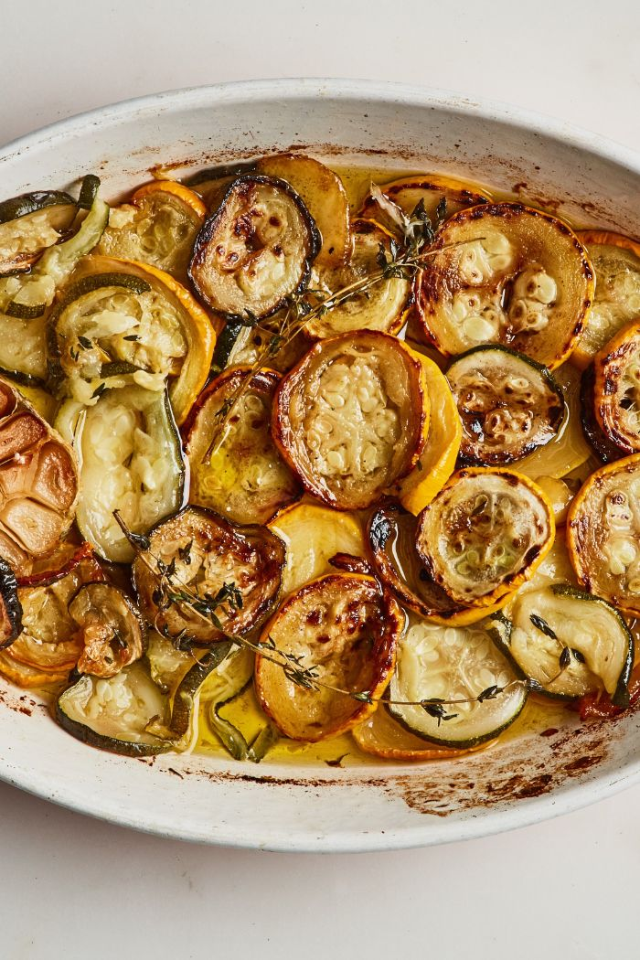 yellow squash recipes baked squash and zucchini slices in butter garnished with thyme twigs
