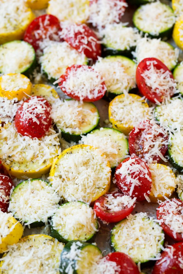zucchini and yellow squash recipes close up photo of squash zucchini and tomato slices covered with grated cheese