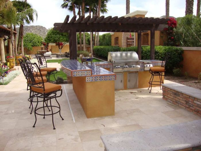 mediterranean style garden home bar ideas on a budget kitchen island with colorful tiles black metal bar stools with orange cushions