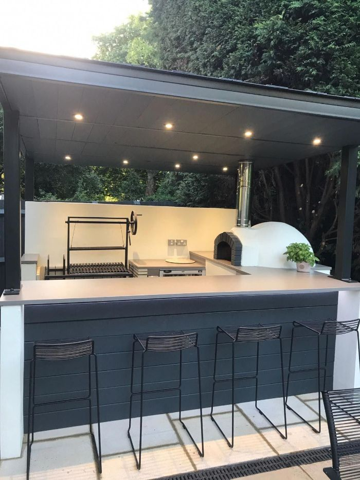 black wooden kitchen island with white countertop diy outdoor bar black metal stools pizza oven