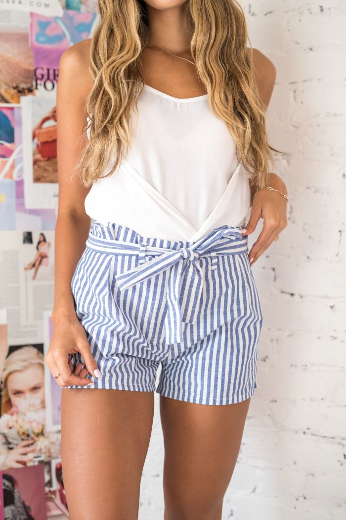 blonde girl wearing blue and white striped shorts white top cute dresses for teens