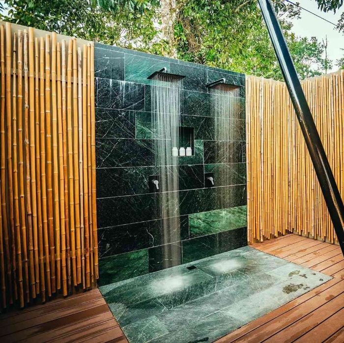 blue and green turquoise marble tiles on the wall and floor outdoor shower designs bamboo sticks on the walls