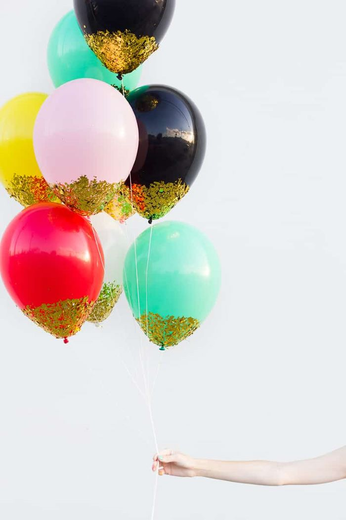 blue black red yellow white balloons dipped in gold paper baby shower decoration ideas for girl white background