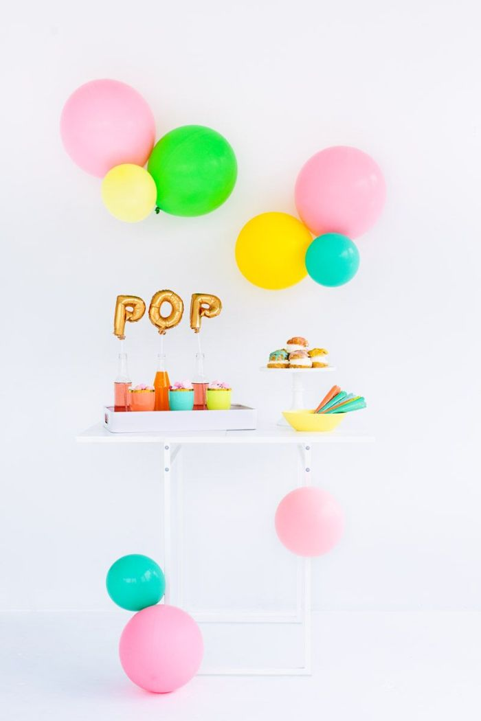blue pink green yellow balloons over table with donuts and lemonade baby shower decoration ideas pop gold balloons