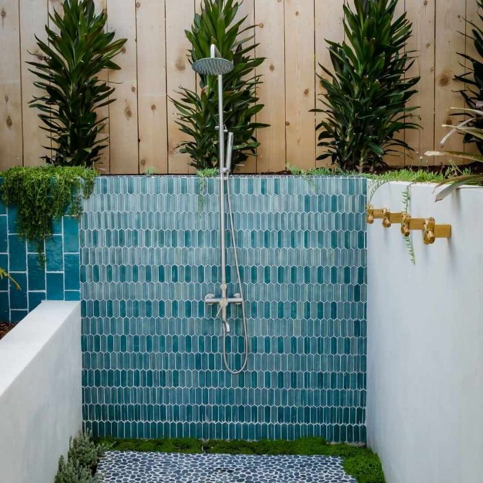 blue tiles on wall where shower head is mounted how to build an outdoor shower blue tiles on the floor