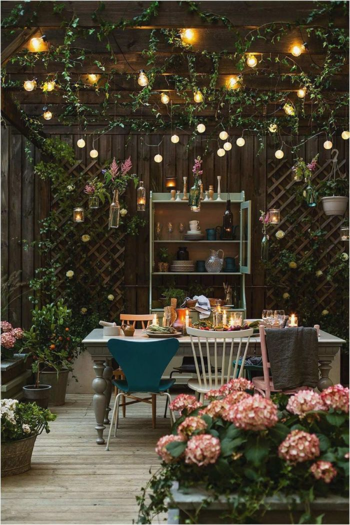 blue white and pink chairs around dining table outdoor hanging lights strings of lights hanging from the ceiling