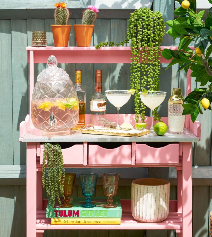 bottles and different glasses pitcher on pink cart with shelves drawers how to build an outdoor bar