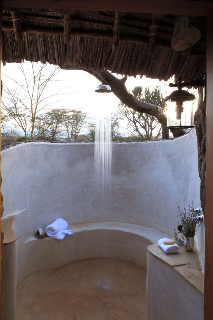cement made wall and bench freestanding outdoor shower hanging from bamboo roof