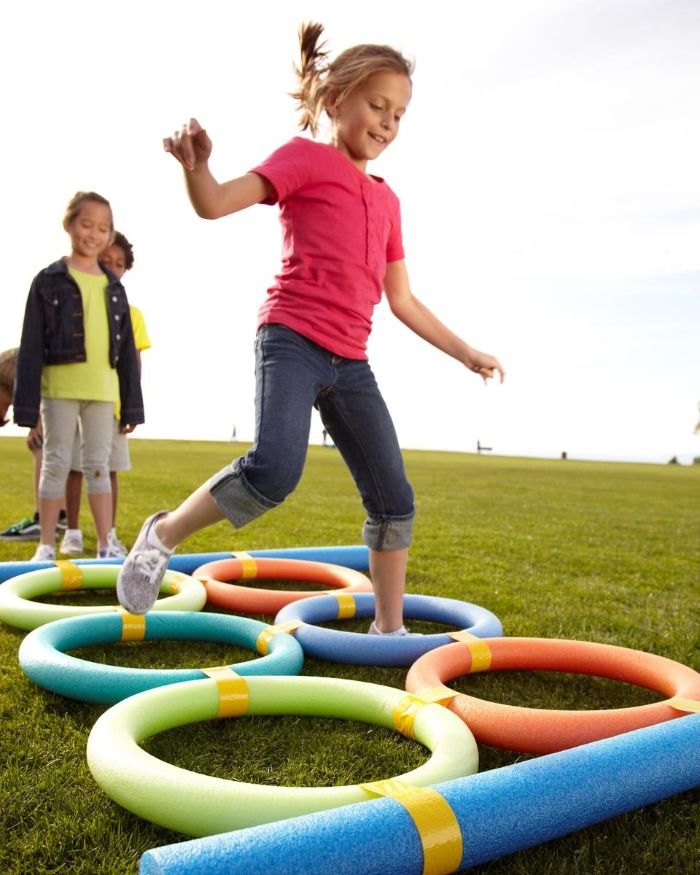 circles made with pool noodles fun things to do outside girls jumping into the circles