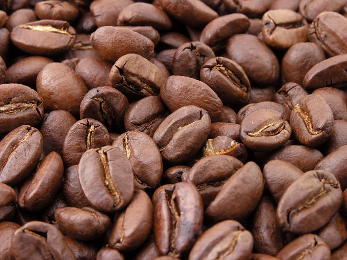 close up photo of lots of coffee beans cold brew coffee