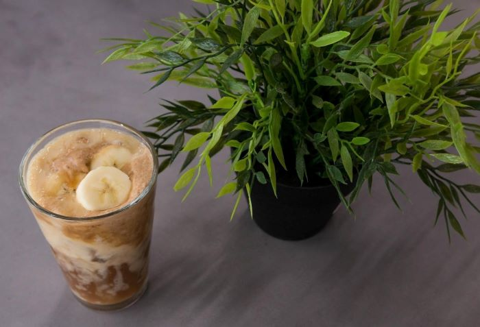 coffee with milk ice cream bananas how to make cold brew coffee placed on gray surface