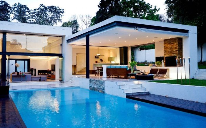 contemporary house with large pool modern pool designs large outside living room area