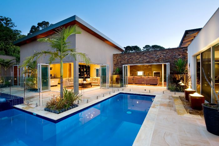 contemporary house with small l shaped pool inground pool design palm trees around it
