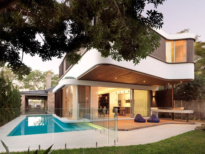 contemporary two storey house small backyard pools two bean bag chairs on the side of pool